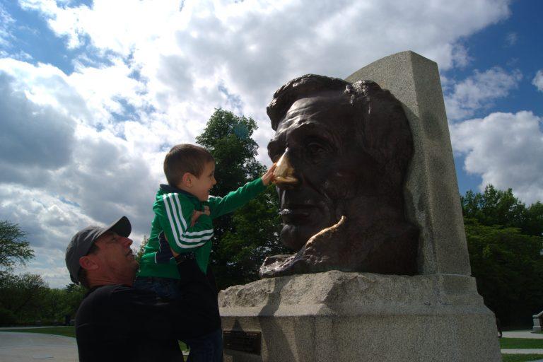 rubbing Lincoln's nose