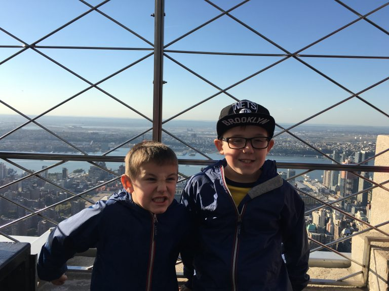 two boys on top of Empire State Building in New York