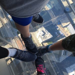The four of us looking down at Willis Tower