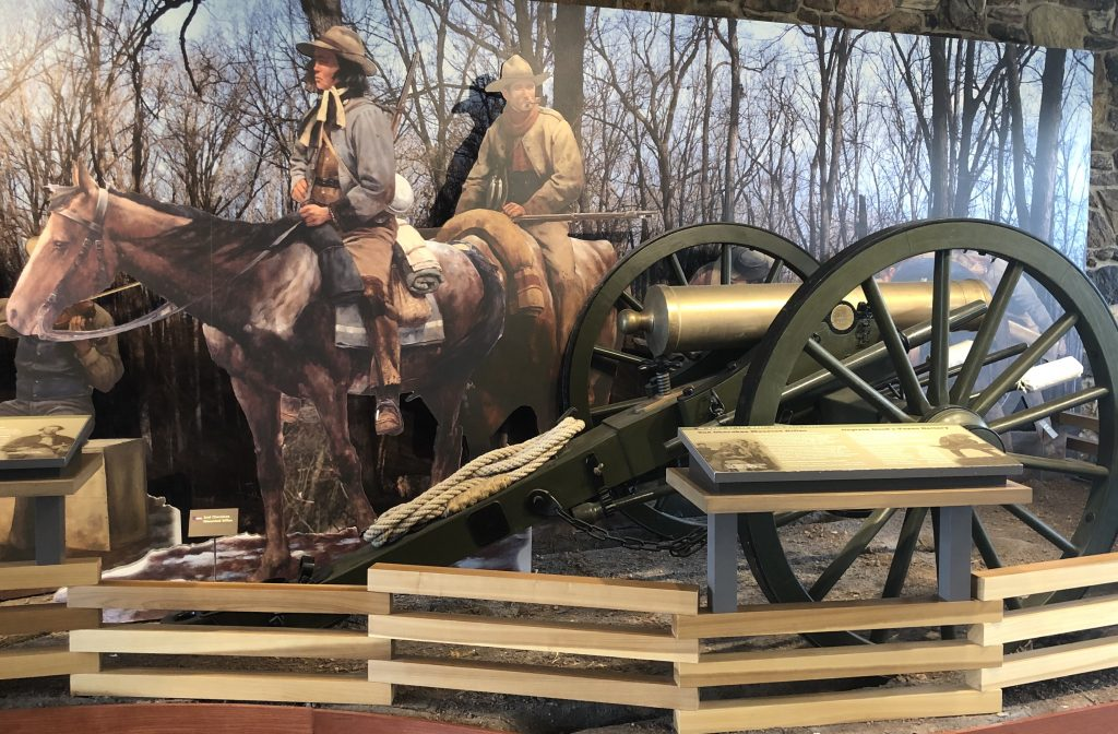 cannon and cutout soldiers at pea ridge national military park