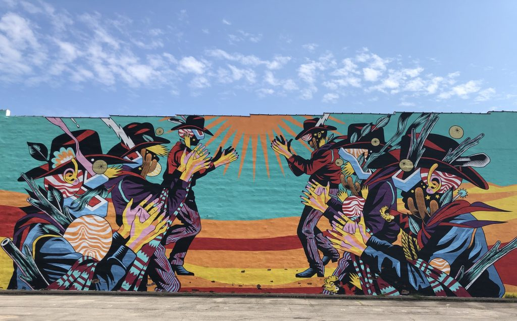 brightly colored mural on brick building in fort smith
