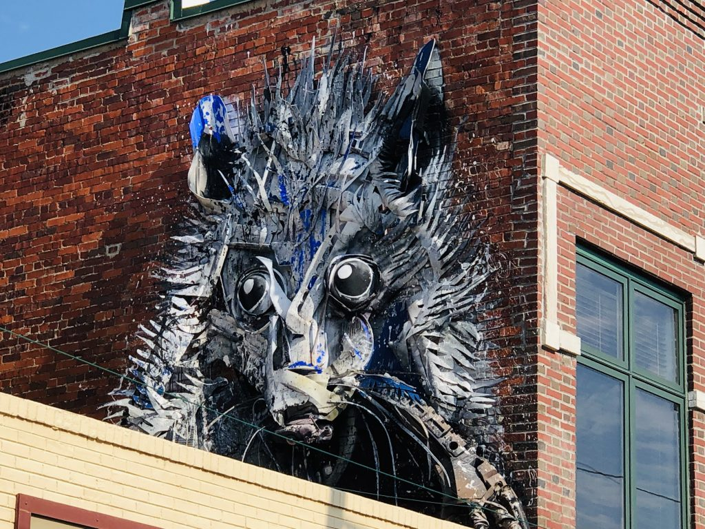opossum mural in brick wall in fort smith