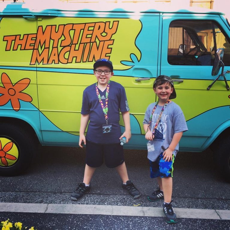 boys in front of scooby doo mystery machine at Universal Studios Orlando